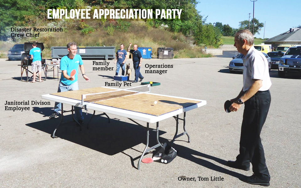 ping pong playing at servicemaster of kalamazoo employee party