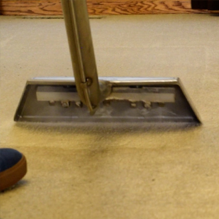 close up of carpet cleaning wand