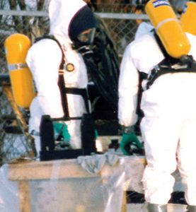 biohazard cleaning with men in full suits and respirators