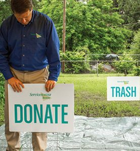 donate and trash signs in tarp in front lawn