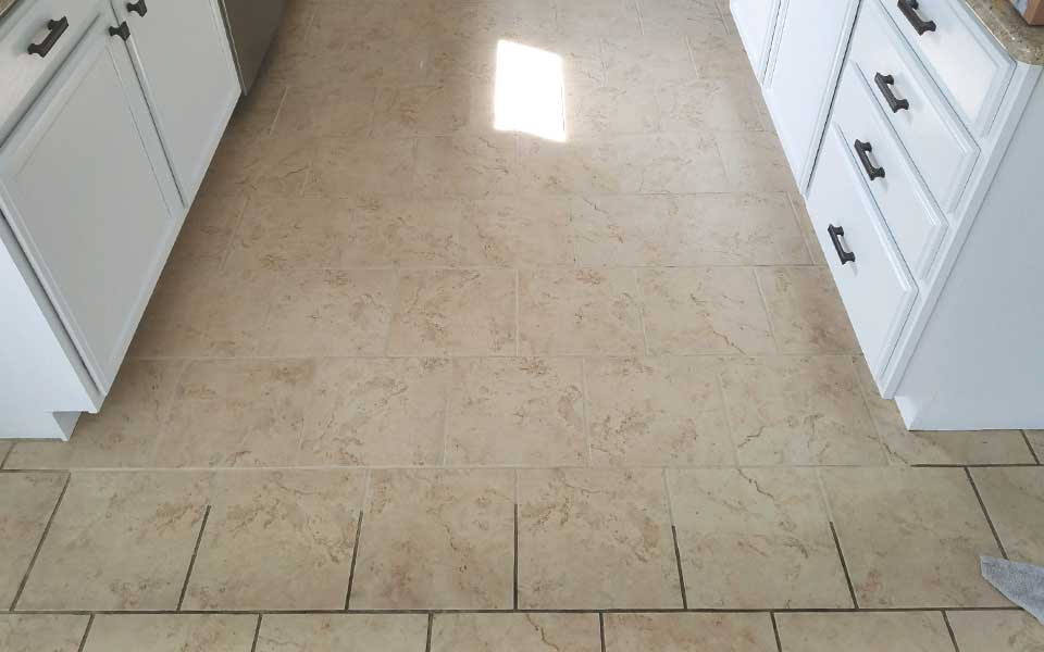 in action before and after tile and grout cleaning