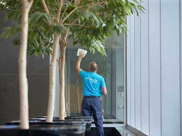 searvicemaster technician cleaning windows