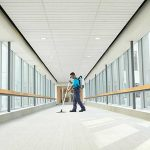 janitorial technician vacuuming floors