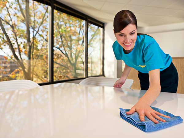 servicemaster technician cleaning office table
